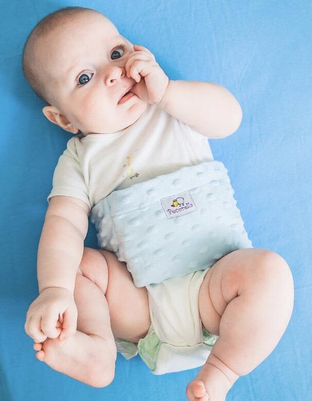 Пояс от коликов для новорожденных: эффект и применение